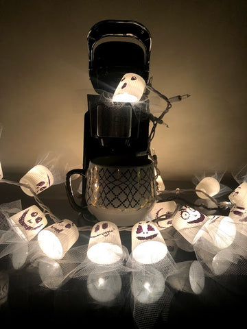 DIY string ghost lights for halloween with recycled k-cup compatible coffee pods.