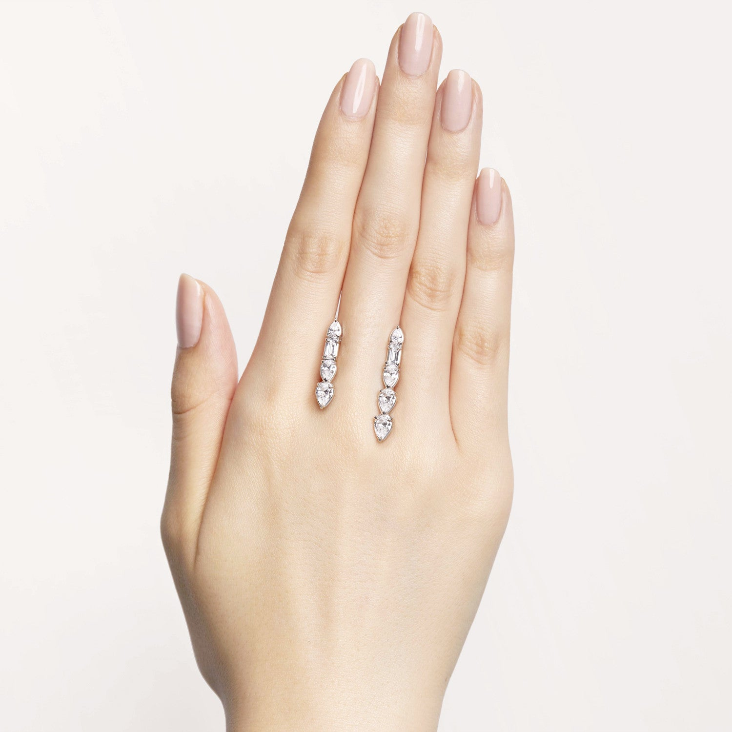 Pear- and baguette-shaped white diamonds floating cuffs on your skin