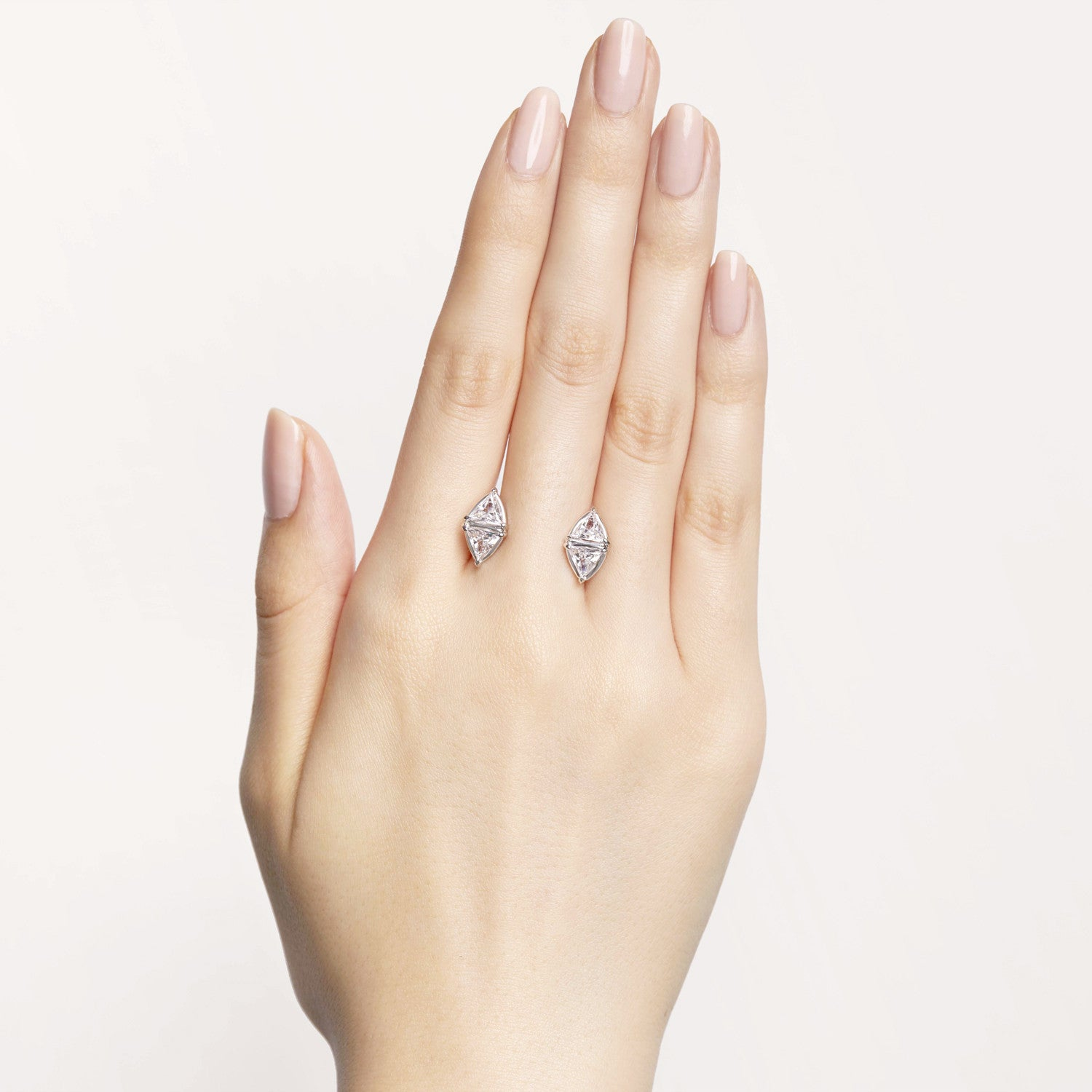 Triangle-shaped white diamonds floating cuffs on your skin