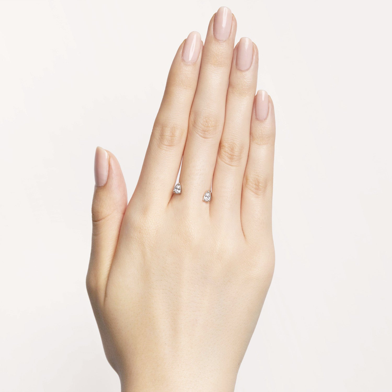 Pear-shaped white diamonds floating cuffs on your skin