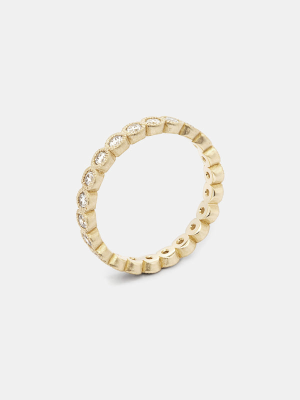 Ammi Eternity Band with 2mm diamonds in 14k yellow gold with signature matte finish.