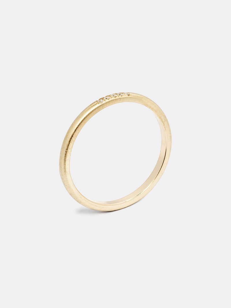 Anise Band in 14k yellow gold with five 1mm recycled diamonds and signature matte finish.