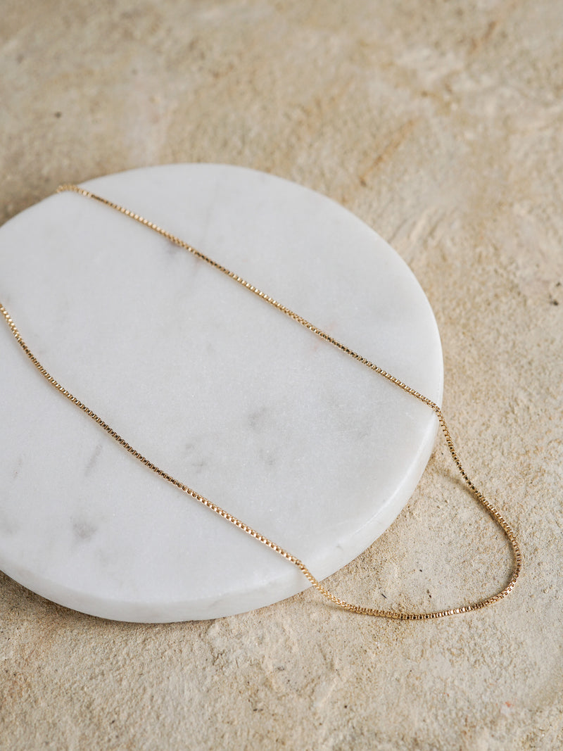 Shown: 1mm box chain in 14k yellow gold.
