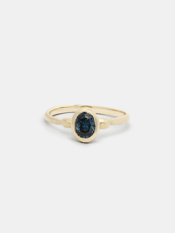 Shown:  0.75ct teal Montana sapphire in 14k yellow gold with organic texture and signature matte finish.
