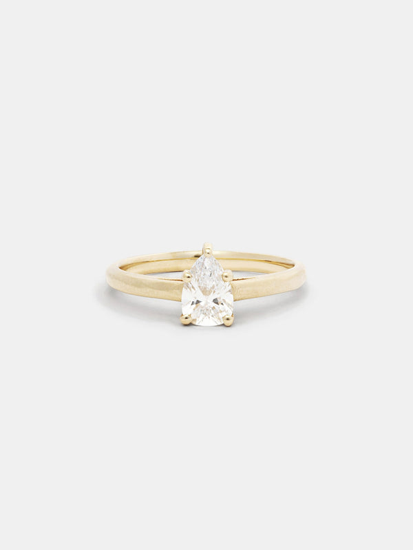 Shown: 0.5ct colorless recycled pear diamond in 14k yellow gold with organic texture and signature matte finish.