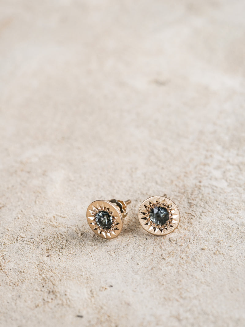 Shown: 0.25ct (4mm) viridian Montana sapphire studs in 14k yellow gold and signature matte finish.