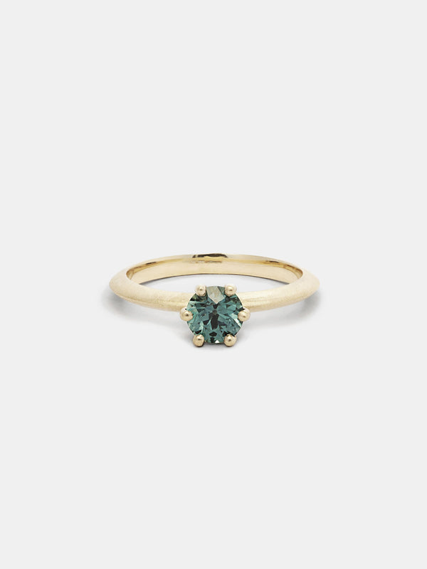 Shown: 0.75ct viridian Montana sapphire in 14k yellow gold with organic texture and signature matte finish.
