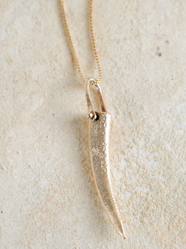 Shown: 14k yellow gold sandcasted pendant on box chain.