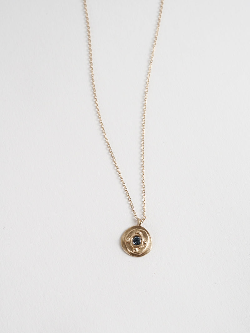 0.25ct viridian Montana Sapphire in 14k yellow gold on a cable chain.
