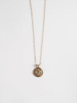 0.25ct antique diamond in 14k yellow gold with organic texture and signature matte finish on a cable chain.