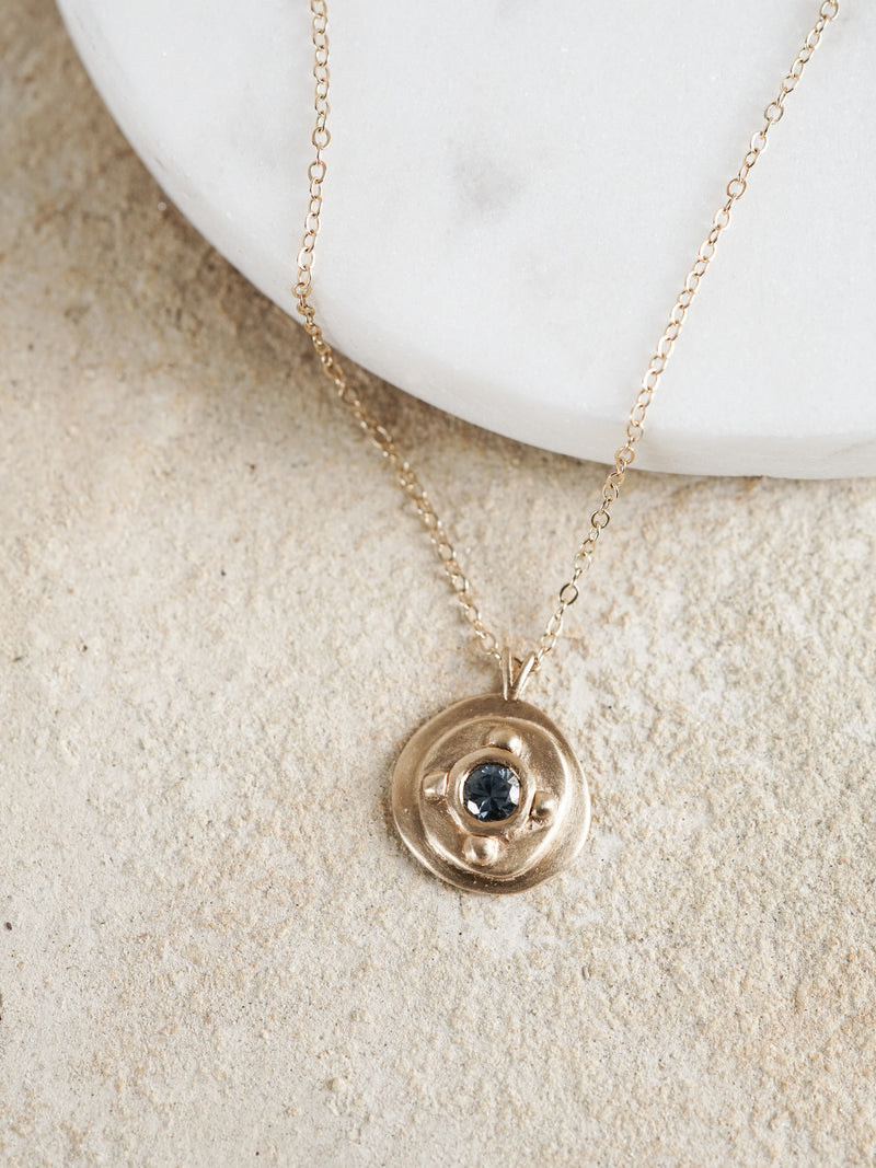 Shown: 0.25ct viridian Montana Sapphire in 14k yellow gold on a cable chain.