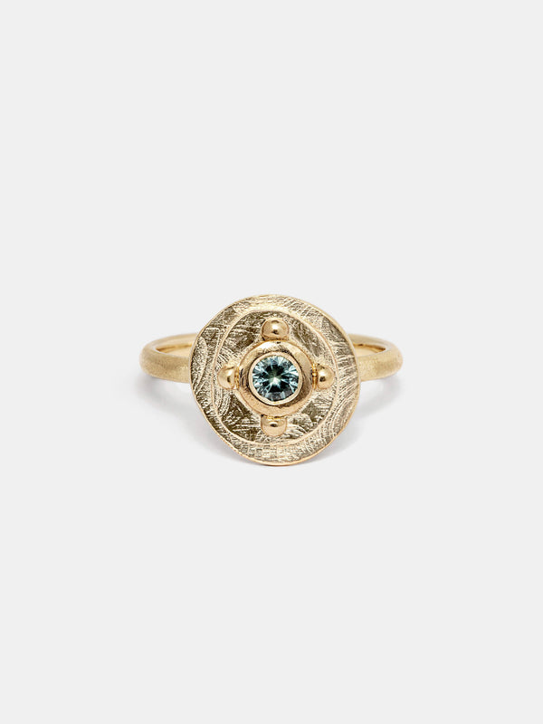 Shown: 0.25ct mint Montana sapphire in 14k yellow gold with organic texture and signature matte finish.