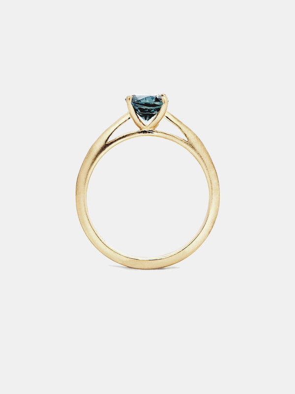 Gardenia Solitaire- Sapphire with 1ct teal Montana sapphire in 14k yellow gold with smooth texture and signature matte finish.