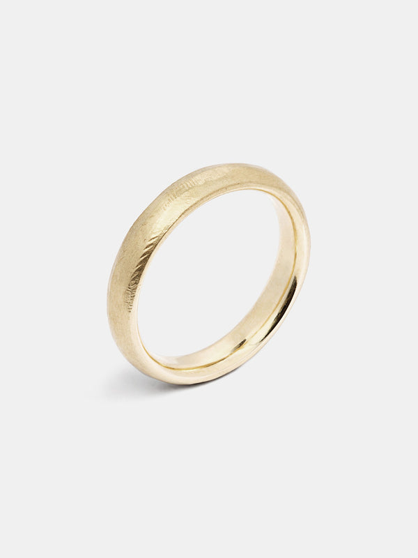 Heath Heavy Band in 14k yellow gold with organic texture and signature matte finish.