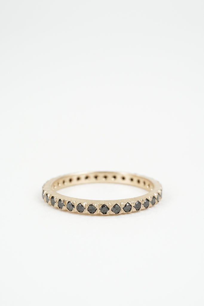 Yellow gold thin band with pave set black diamonds