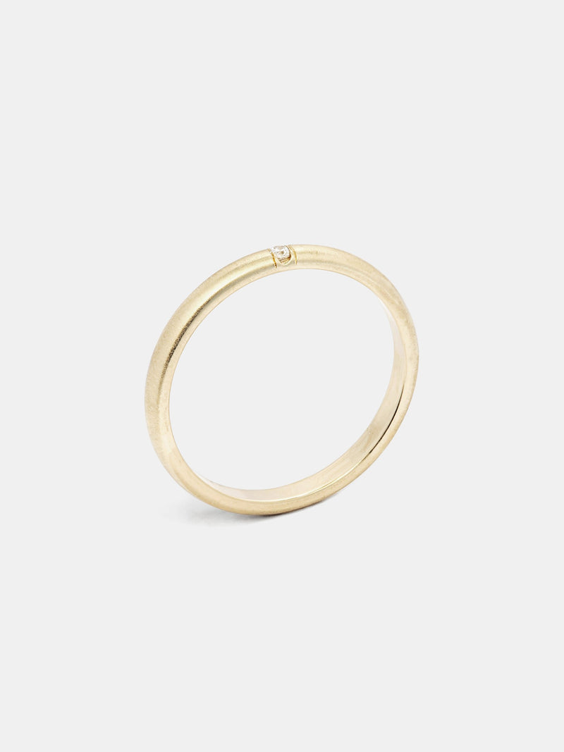 Luna Band in 14k yellow gold with one 1.5mm recycled diamond and smooth texture with signature matte finish.