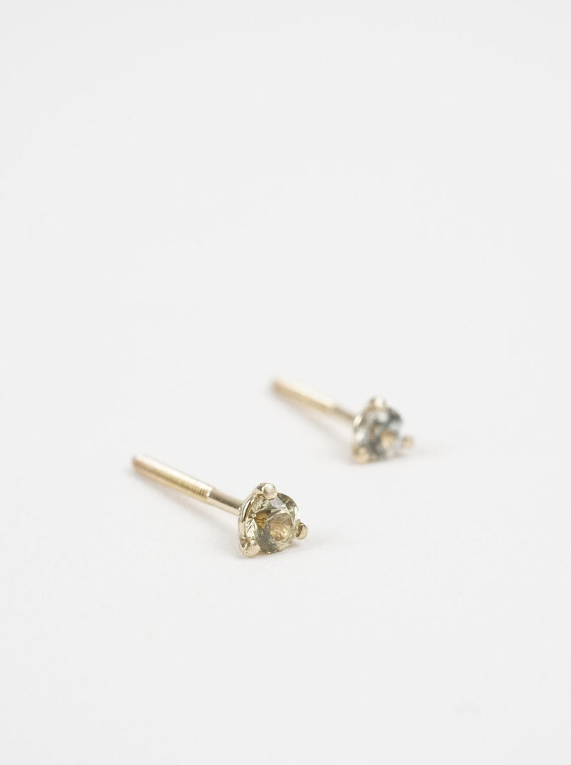 Shown: Green 3mm Montana sapphire studs in 14k yellow gold.