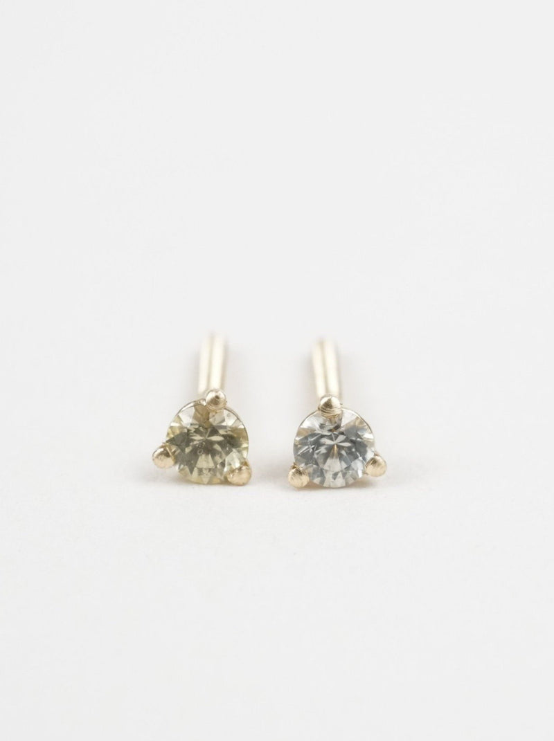 Shown: (left) green 3mm Montana sapphire; (right) blue 3mm Montana sapphire in 14k yellow gold.