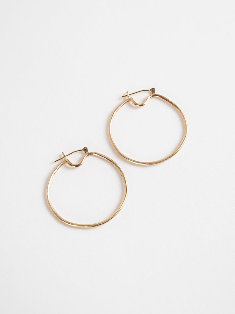 Shown: Orb Hoops - Small in 14k yellow gold with signature matte finish.