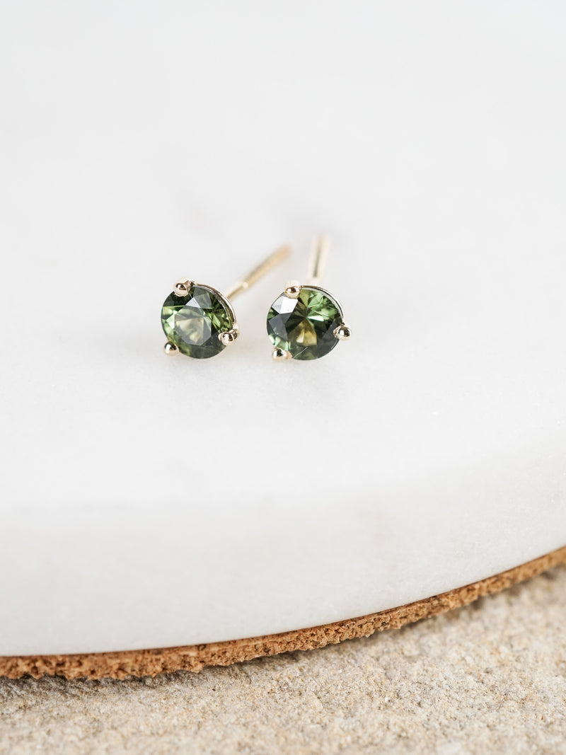 Shown: green Montana sapphires set in 14k gold.