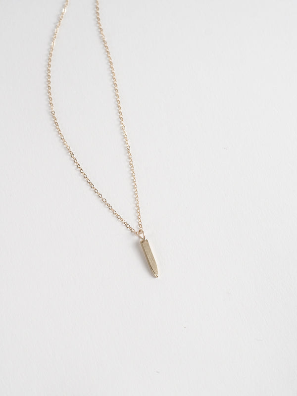 Pendulum necklace in 14k yellow gold on cable chain.