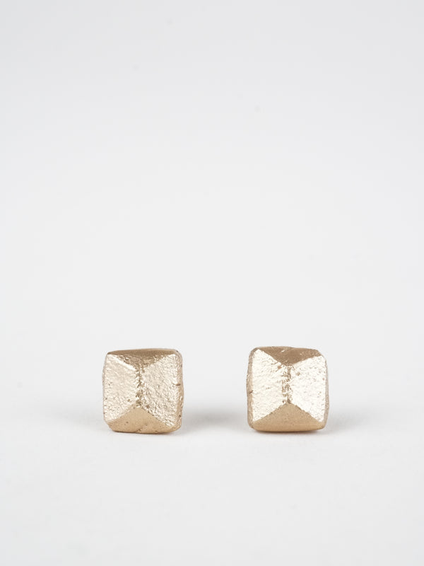 Pyramid sandcasted studs in 14k yellow gold in our signature matte finish.