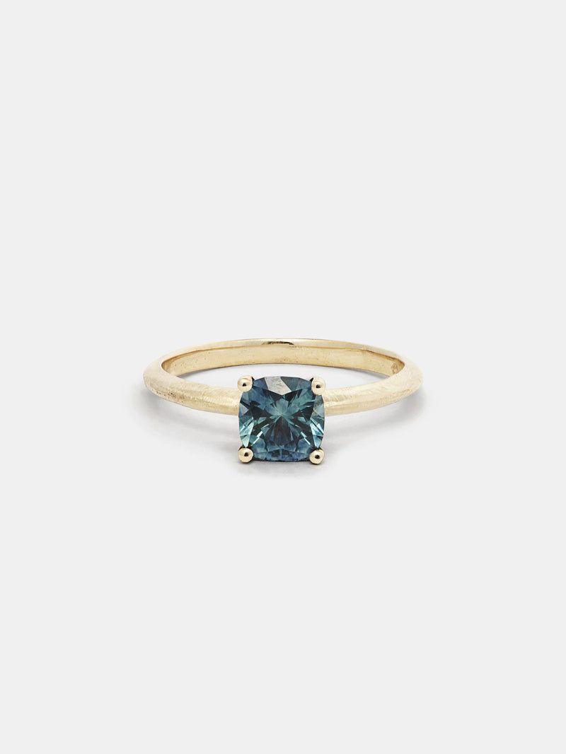 Shown: 1ct teal Montana sapphire 14k yellow gold with organic texture and signature matte finish.
