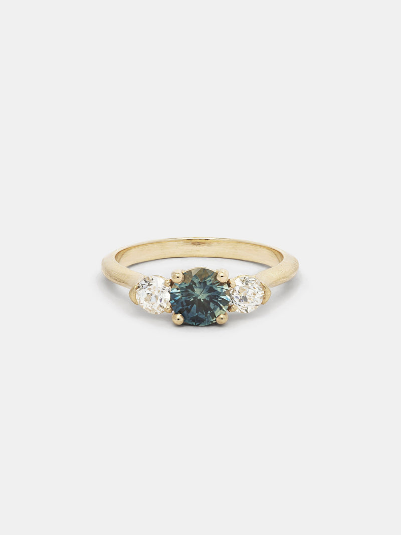 Shown: 0.5ct viridian Montana sapphire center stone with 0.2ct near colorless antique side stones in 14k yellow gold with organic texture and signature matte finish.
