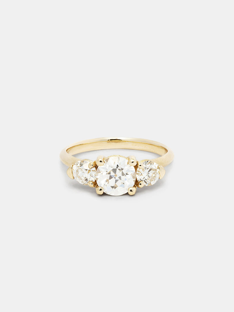 Shown: 1ct near colorless antique center stone with 0.3ct near colorless antique side stones in 14k yellow gold with organic texture and signature matte finish.