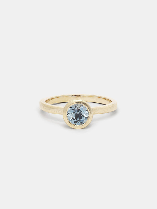 Shown: 1ct aqua Montana sapphire in 14k yellow gold with organic texture and signature matte finish.