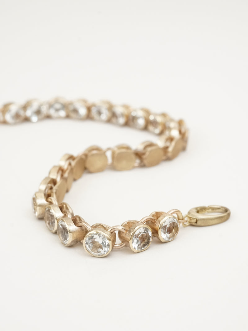 Shown: white topaz set in 14k yellow gold with signature matte finish.