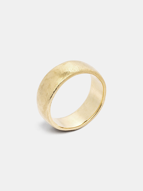 Wide Band in 14k yellow gold with organic texture and signature matte finish.