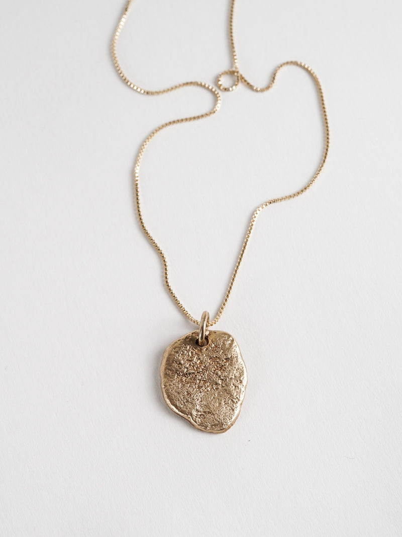 Shown: sandcasted 14k gold pendant on box chain.