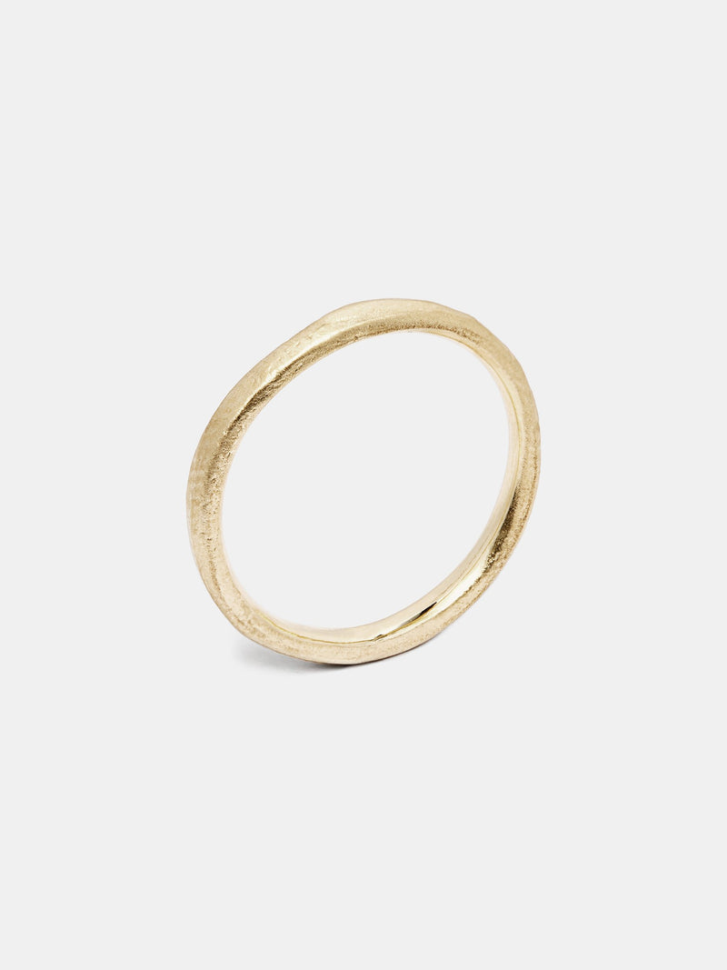 Zinnia Band in 14k yellow gold with organic texture and signature matte finish.