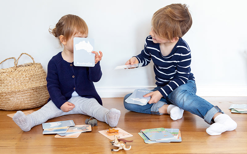 Kids playing with Australian themed flashcards