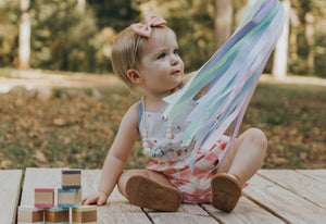 toddler-girl-playing-with-best-pastel-rainbow-hand-kite
