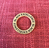 Black Excellence Ring - Lapel Pin