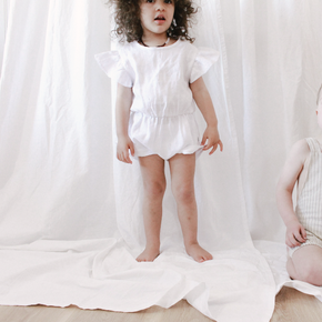 the cutest summer romper, made from super soft white linen