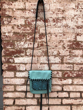 "Turquoise with Black & Turquoise Embossed Leather ""Penny"" Bag"