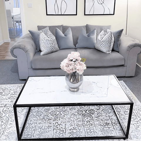 A striking monochrome theme is given a softer edge with plush grey fabrics and furnishings.