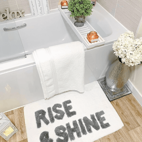 There's a more casual vibe in the bathroom, but it's no less luxurious, with a stack of pure white Hampton and Astley indulgently thick Egyptian cotton towels.