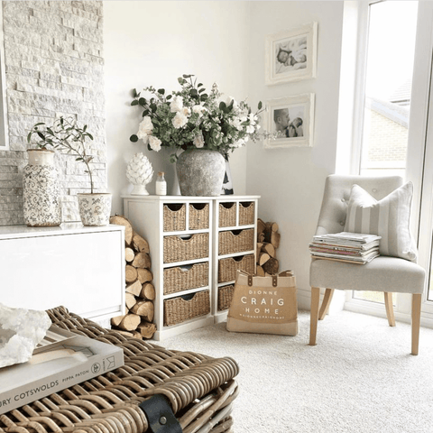 Along with accents of natural wood and wicker, plus a stunning white flower and eucalyptus arrangement.