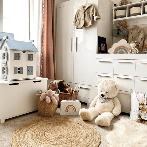 The softest of pinks and buttery oatmeal shades make this nursery room the perfect place for a little one to play.
