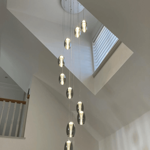 Lit by stunning brushed chrome pendant lights that hang from the double height ceiling.