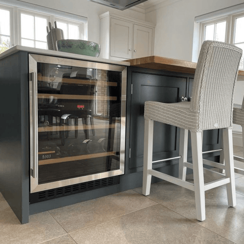 The spacious kitchen has plenty of room for a central island, complete with a super handy wine cooler.