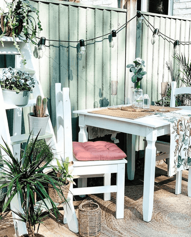 With a couple of coats of white paint, an old wooden table and chair set can look really cute