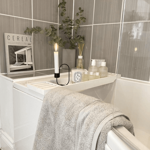 Relaxation is never far away in the calming, neutral themed bathroom, complete with a set of Hampton and Astley indulgently thick towels in subtle grey.