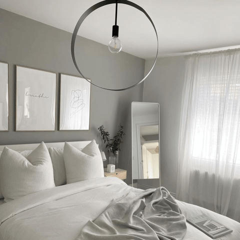 Aimee's bedroom is a masterclass in cool and calming elegance.
