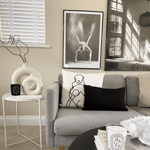 Monochrome artwork hangs throughout the home, complemented here by two stylish donut vases.