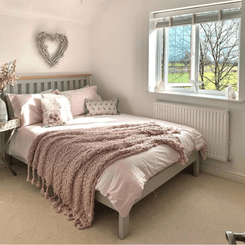 The bedroom has a breathtaking view of the countryside and features Hampton and Astley Egyptian cotton sateen bedding in pink